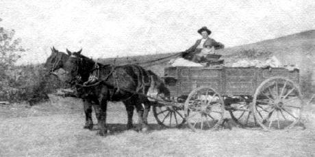 Hadley Bean & Blanche in horse-drawn wagon leaving ranch